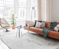 Shop the look: cognac-coloured sofa in a white interior